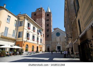 Albenga, liguria, italy - june 2019: The St Michael cathedral and square in Albenga, with the new town hall.  Liguria, Italy.