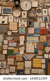 ALBENGA, LIGURIA, ITALY - JUNE 2019: Wall with many celebrative signs in the slingback district of Albenga, Liguria, Italy.