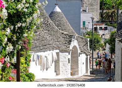 Alberabello, Italy - June 28, 2014: A trullo is a traditional Apulian dry stone hut with a conical roof.