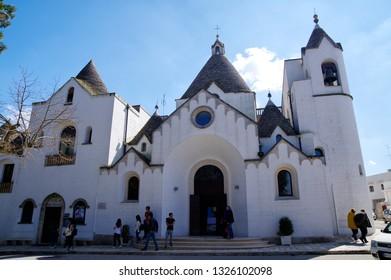 ALBEROBELLO, APULIA, ITALY - MARCH 29th, 2018: St. Antonio Trullo Church in center of Alberobello. Alberobello is a small town in the south of Italy famous for the trulli houses.