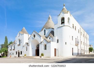 Alberobello, Apulia, Italy - Visiting the famous traditional church of Alberobello