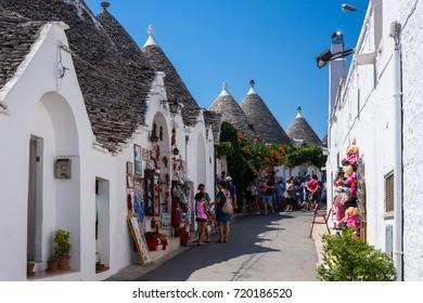 ALBEROBELLO, ITALY - August 10, 2017: People visit Alberobello, Italy. Alberobello and its trulli houses are a UNESCO World Heritage Site.
