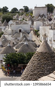 ALBEROBELLO - ITALY - AUGUST 27 2017: Overview of the city of Alberobello in Puglia, Italy, Unesco site with its traditional trullo buildings