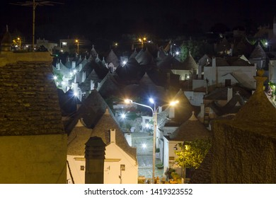 ALBEROBELLO, ITALY - AUGUST 27 2017: Night view of Alberobello town in South Italy, famous for its Trulli