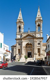 Alberobello, Italy - June 28 2014: Basilica of Saints Cosmas and Damian in  Piazza Antonio Curri in Alberobello.