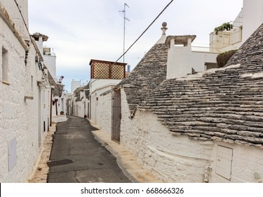 Alberobello, Italy - June 6, 2017: Empty street in Alberobello, a small town and comune of the Metropolitan City of Bari. It has about 10,700 inhabitants and is famous for its unique trullo buildings.