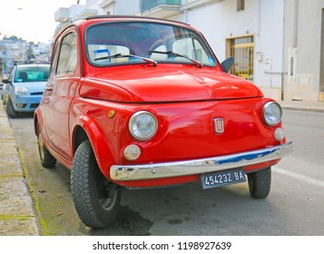 Alberobello, Italy - March 15, 2015: The iconic Fiat 500 (1970 design) on a street in Alberobello, small town of the Metropolitan City of Bari, Puglia, Southern Italy.