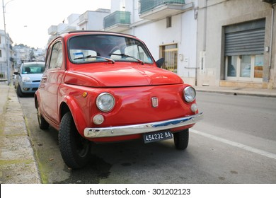 ALBEROBELLO, ITALY - MARCH 15, 2015: The iconic Fiat 500 on a street in Alberobello, small town of the Metropolitan City of Bari, Puglia, Southern Italy.