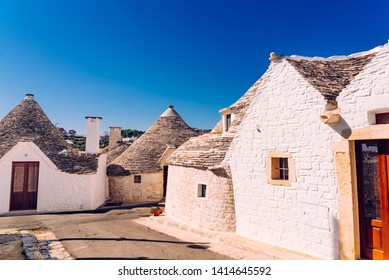 Alberobello, Italy - March 5, 2019: Narrow streets between the trulli of Alberobello, in southern Italy, ideal for family trips.