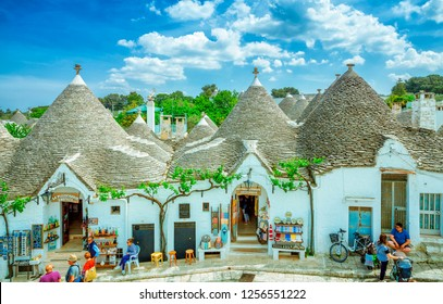 ALBEROBELLO, ITALY - MAY 05, 2018: Town of Alberobello, village with Trulli houses in Puglia region, Southern Italy.  Trulli of Alberobello have been designated as a UNESCO World Heritage.