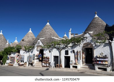 ALBEROBELLO, ITALY - MAY 29, 2017: People visit Alberobello, Italy. Alberobello and its trulli houses are a UNESCO World Heritage Site.