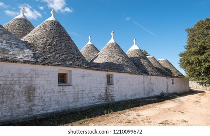 Alberobello Italy, September 2018. Group of traditional white washed conical roofed houses in the area of Alberobello in the Itria Valley, Puglia, Southern Italy.