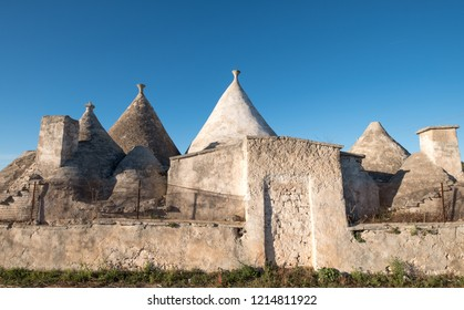 Alberobello Italy, September 2018. Group of unique round Trulli houses with cone shaped roofs in the area of Alberobello in the Itria Valley, Puglia, Southern Italy.