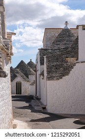 Alberobello Italy, September 2018. Group of unique round Trulli houses with cone shaped roofs in Alberobello in the Itria Valley, Puglia, Southern Italy.
