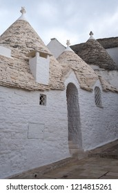 Alberobello, Italy. September 2018. . White-washed conical roofed trulli house with arched doorway in the town of Alberobello in Puglia, Southern Italy.