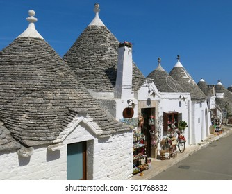 Alberobello, Italy trulli trullo beneath cloudless blue sky. Alberobello is famous for its trulli, the plural of trullo, which are unusual dry stone structures with a conical roof.