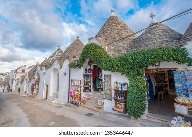 ALBEROBELLO, PUGLIA, ITALY - March 14, 2019: View of Alberobello's famous Trulli, the characteristic cone-roofed white houses of the Itria Valley, Apulia, Southern Italy.