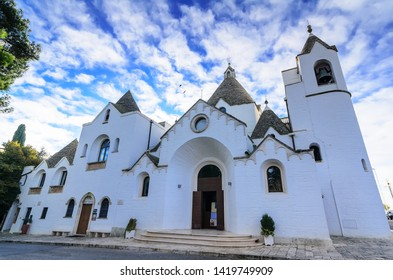 Alberobello/Italy/10.21.2016  Church in Alberobello built in the style of Trullo. A trullo is a traditional Apulian dry stone hut with a conical roof.