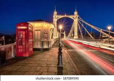 Albert bridge illuminated by lights at night with traffic