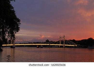 Albert Bridge, London,UK. View of Albert Bridge in the evening sunset with lights on the bridge being on.