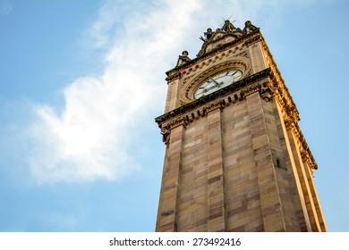 Albert Memorial Clock tower in Belfast in Northern Ireland with blie sky in the background