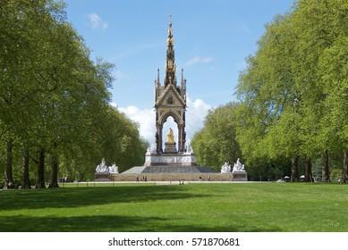 The Albert Memorial in Kensington Gardens, London viewed through avenue of trees basking in summer sunshine