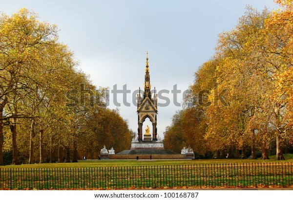 The Albert memorial surrounded by beautiful golden autumn trees. London, UK