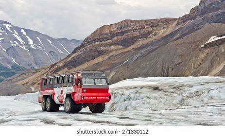 ALBERTA, CANADA - APR 15, 2015: Ice Explorers, designed for glacial travel, take tourists onto the surface of the Athabasca Glacier in the Columbia Icefields, Canada.