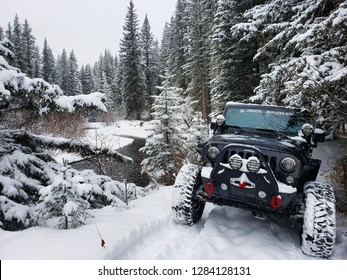 Alberta, Canada - December 12, 2018: Black Jeep Wrangler JK Unlimited Rubicon On Winter Mountain Trail
