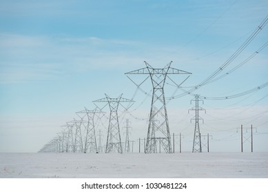 Alberta, Canada.  Electricity pylons/transmission towers on the Prairies in winter.