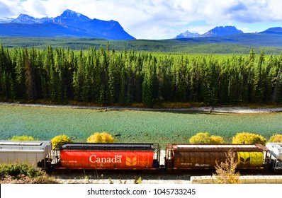 ALBERTA, CANADA - October 1,2017: Long freight train moving along Bow river in Canadian Rockies ,Banff National Park, Canadian Rockies,Canada.