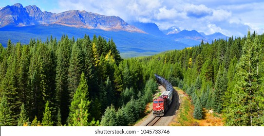 ALBERTA, CANADA - October 1,2017: Long freight train Canadian Pacific Railway (CPR) moving along Bow river in Canadian Rockies ,Banff National Park, Canadian Rockies,Canada.