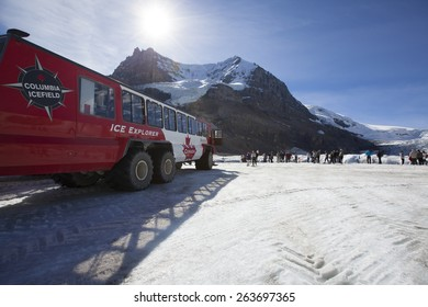ALBERTA, CANADA - SEPTEMBER 8,2012:  Ice Explorers, designed  for glacial travel, take tourists onto the surface of the Athabasca Glacier on September 8,2012  in the Columbia Icefields, Canada.