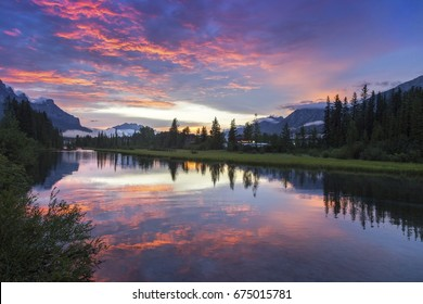 Alberta Foothills Dramatic Burning Red Sunset Sky Landscape in City of Canmore after late afternoon Canadian Rockies summer thunderstorm