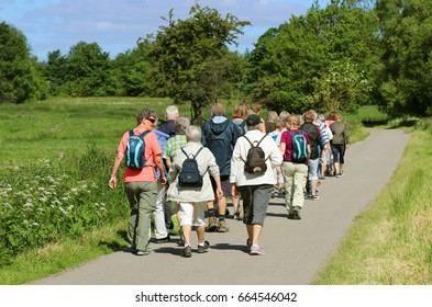 ALBERTSLUND, DENMARK - JUNE, 20, 2017:Happy group of seniors walking in the nature. This is a walking holiday.