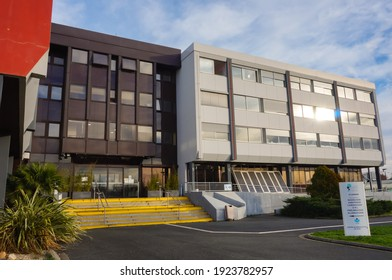 Albi - Caussels, France - Dec. 2020 - Main entrance, and bay windows on the front facade of the private hospital Toulouse-Lautrec, a medical facility operated by the Occitanie-based company Clinipôle