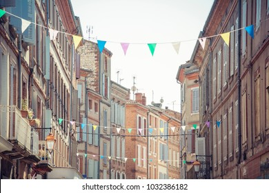 Albi city centre, Tarn, Occitanie, France - Cityscape - Traditional facades and festive garlands in the center of the old town
