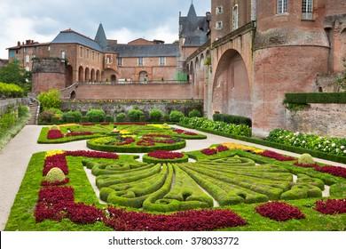 ALBI, FRANCE - AUGUST 09: Palais de la Berbie Gardens at Albi, Tarn, France on August 09, 2014. Beautiful flowerbed