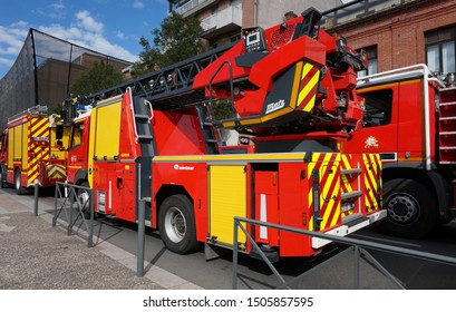 Albi, France - July 14, 2019 - Fire trucks from the fire brigade of Departement of Tarn, participating in Bastille Day military parade, specifically one equiped with a telescopic ladder