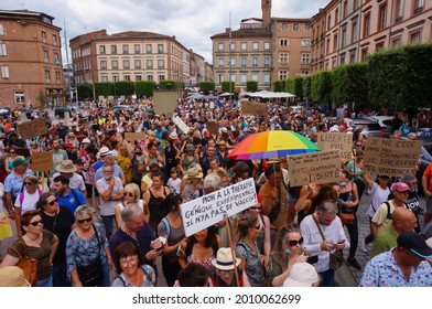Albi, France - July 17, 2021 - Large crowd of protesters gathering on Sainte-Cécile Square to oppose the vaccine mandate for health workers and sanitary passport imposed by the French government