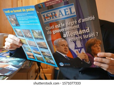 """Albi, France - Nov. 2012 - French edition of """"News from Israel"""", headlined """"How reliable is the German government's friendship to Israel ?"""", showing a photo of PM Netanyahu with Chancelor Merkel"""