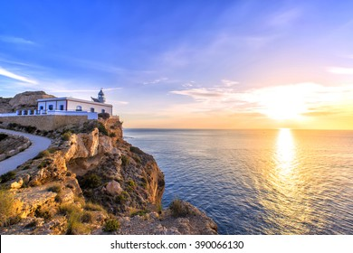 Albir lighthouse beautifully located on top of a cliff.
