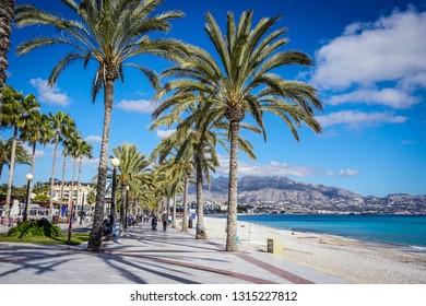 ALBIR, SPAIN -February 13,2019: Beautiful beaches of Albir in Spain with anchor monument