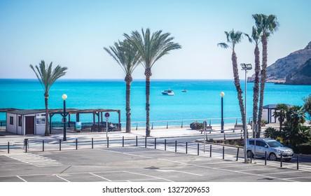 ALBIR, SPAIN - FEBRUARY 28, 2019: Beautiful beach in Albir, weekday routine