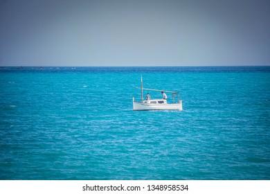 ALBIR, SPAIN - MARCH 25, 2019: Boat on the beautiful beach of Albir