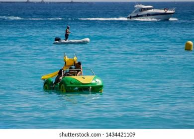 Albir, Spain - September 11 2011:   A Pedalo, a dinghy and a Power boat all in the sea off Albir Beach by Passeig De Les Estreles