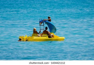 Albir, Spain - September 11 2011:   A pedalo with built on slide in the sea off Albir Beach by Passeig De Les Estreles