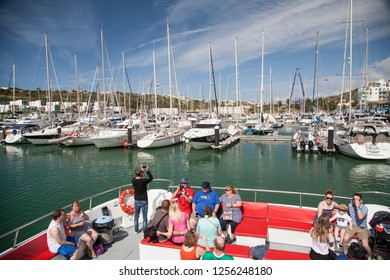 Albufeira, Algarve / Portugal - 06/07/2018: Tourists on a boat ride in the marina of Albufeira