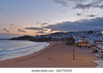 Albufeira, Algarve / Portugal - April 04 2019: Fishermen Beach or Praia dos Pescadores during twilight