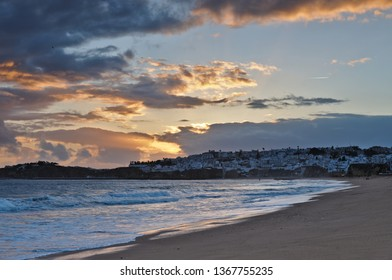 Albufeira, Algarve / Portugal - April 04 2019: Scenery of the city of Albufeira from the beach during twilight